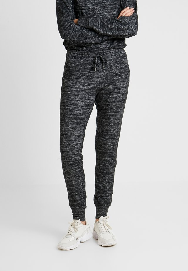 COZY - Jogginghose - black