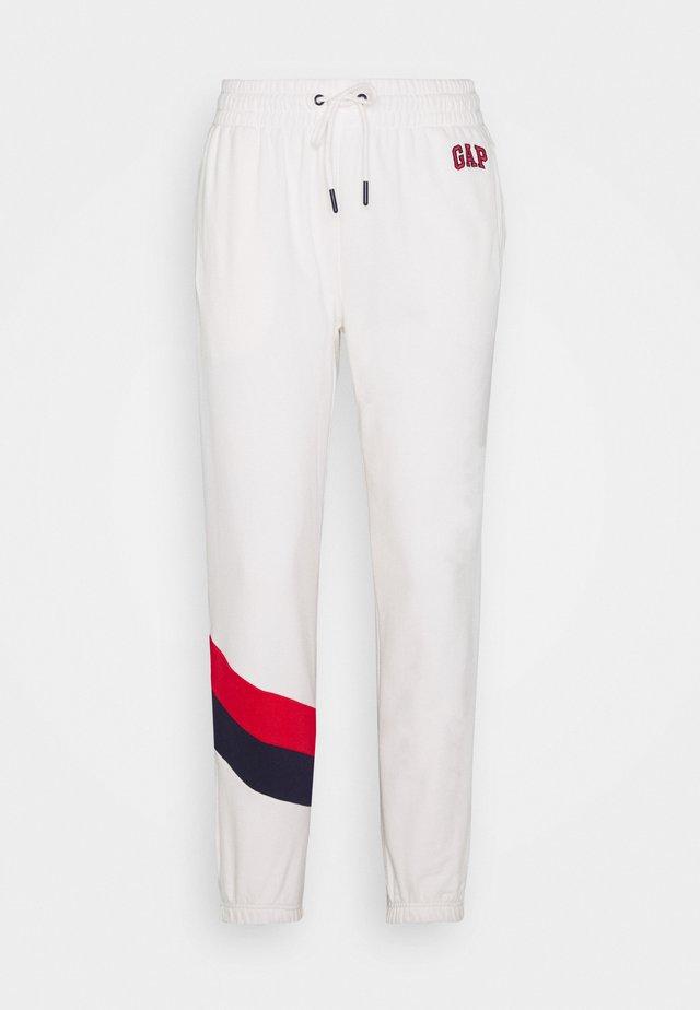 Spodnie treningowe - milk