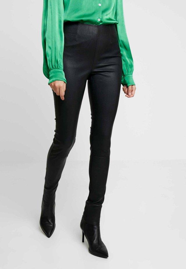 Spodnie skórzane - black