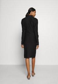 Gestuz - RIFAGZ SLIM DRESS - Žerzejové šaty - black - 2