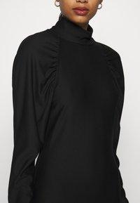 Gestuz - RIFAGZ SLIM DRESS - Žerzejové šaty - black - 5