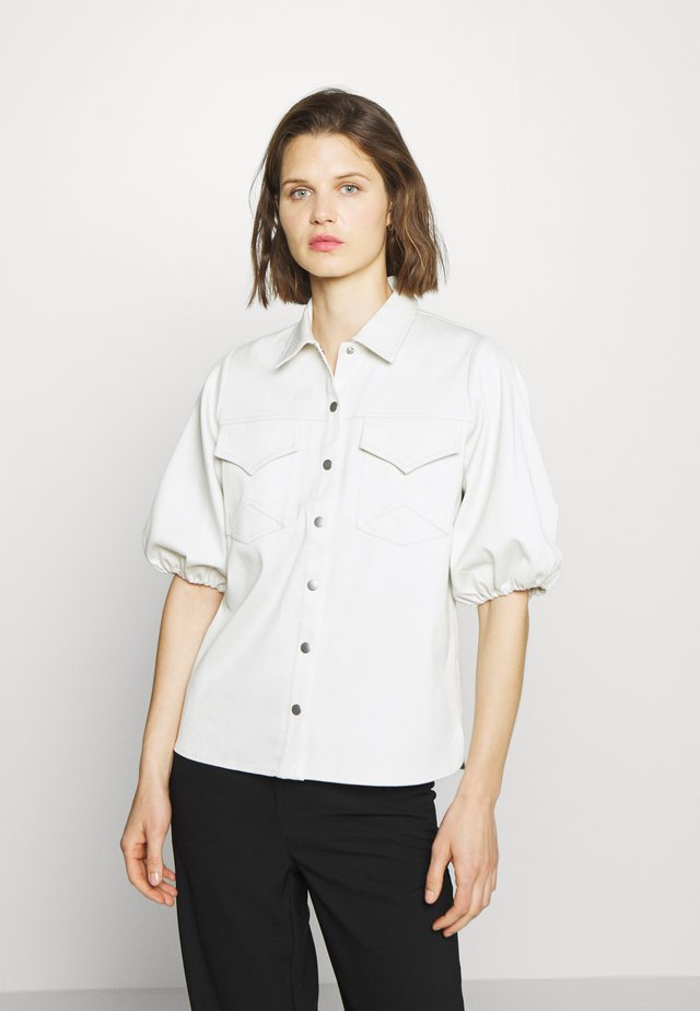VANJO - Button-down blouse - blue blush