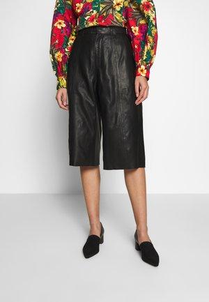 SURI - Leather trousers - black