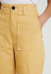 Ghospell - HABITAT TROUSERS - Bukser - yellow - 3