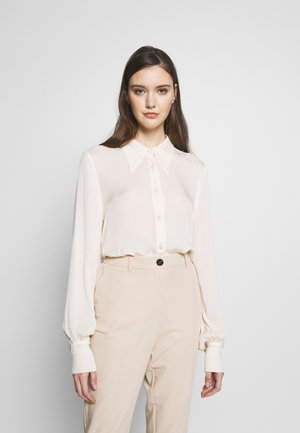 BLOUSE - Button-down blouse - ivory