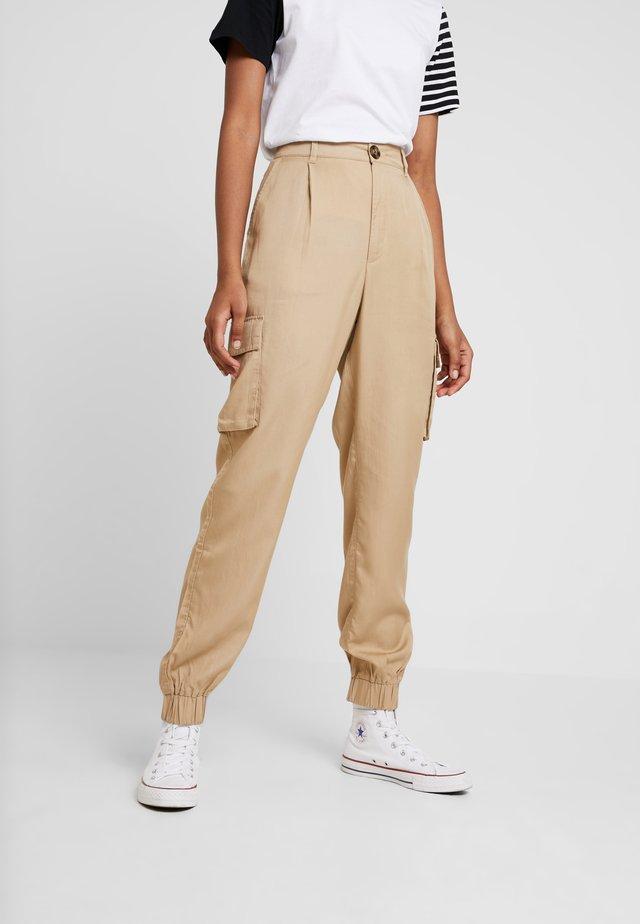 PAULA TROUSER - Spodnie materiałowe - beige