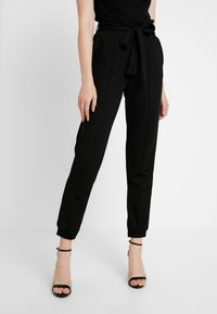Gina Tricot - INES TROUSERS - Trousers - black - 0