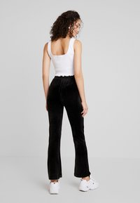 Gina Tricot - CECILIA TROUSERS - Tracksuit bottoms - black - 3