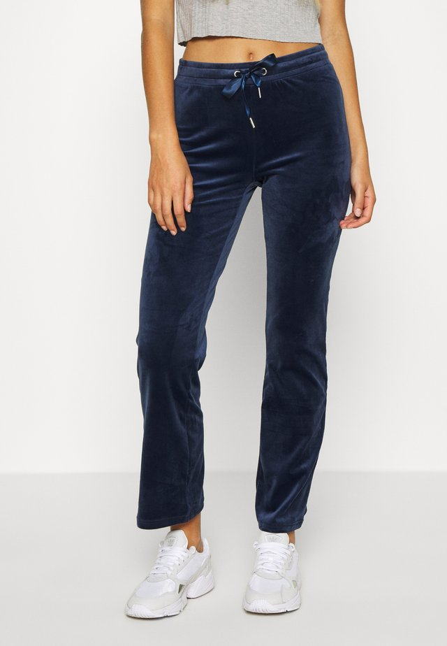 CECILIA TROUSERS - Tracksuit bottoms - evening blue
