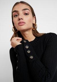 Gina Tricot - EXCLUSIVE SIGNE DRESS - Gebreide jurk - black - 5