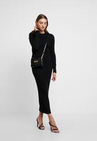 Gina Tricot - EXCLUSIVE SIGNE DRESS - Gebreide jurk - black - 2