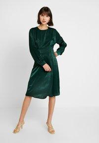 Gina Tricot - EXCLUSIVE SANDRA DRESS - Day dress - pine grove - 0