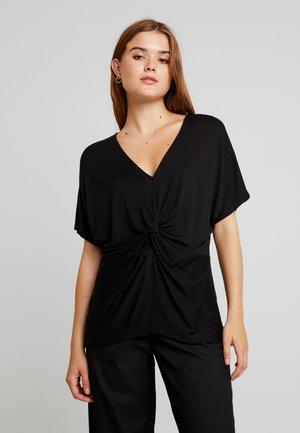 DONNA - T-shirt con stampa - black