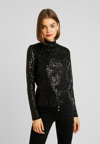 Gina Tricot - EXCLUSIVE HOLLY GLITTER POLO - Blůza - black - 0