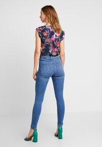 Gina Tricot - MOLLY HIGHWAIST - Skinny džíny - midblue
