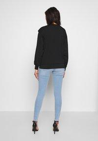 Gina Tricot - MOLLY HIGHWAIST - Jeans Skinny - light blue - 2