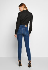 Gina Tricot - MOLLY HIGHWAIST - Jeans Skinny Fit - dark blue