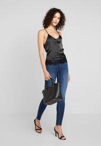 Gina Tricot - BONNIE - Jeans Skinny Fit - dark blue - 1