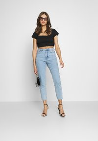 Gina Tricot - DAGNY HIGHWAIST - Jeans Tapered Fit - light blue - 1