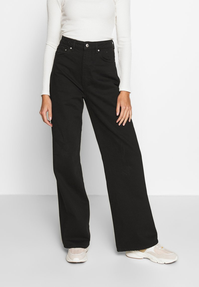 Gina Tricot - WIDE LEG  - Flared jeans - black