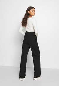 Gina Tricot - WIDE LEG  - Flared jeans - black - 2