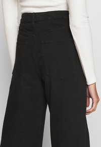 Gina Tricot - WIDE LEG  - Flared jeans - black - 3