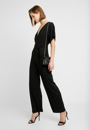 TAKI - Jumpsuit - black