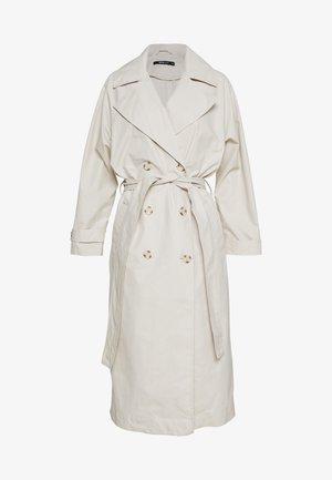 CORINNE - Trenchcoat - beige