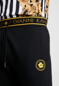 Gianni Kavanagh - BACK JOGGERS  - Tracksuit bottoms - black - 4
