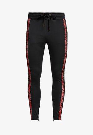 SNAKE  TRACKSUIT - Pantalones deportivos - black