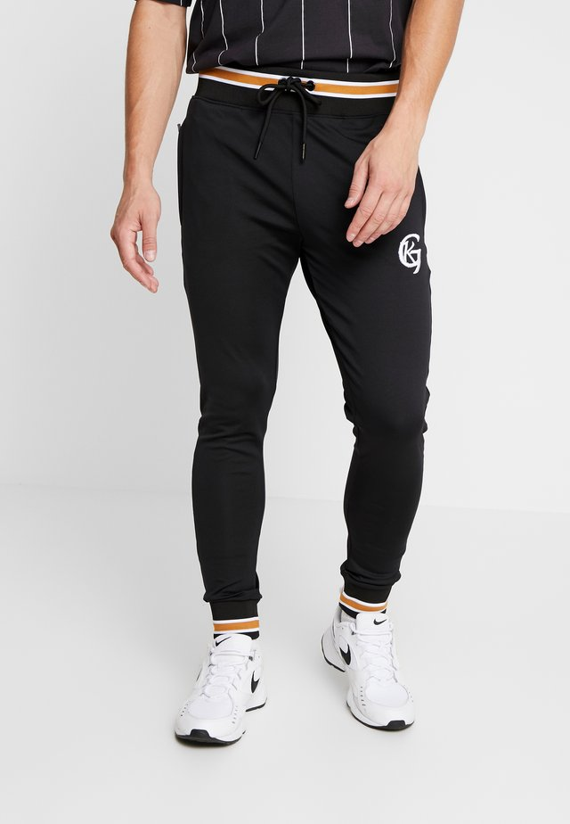 TRACKSUIT JOGGER WITH STRIPED OCHRE RIB - Pantalon de survêtement - black