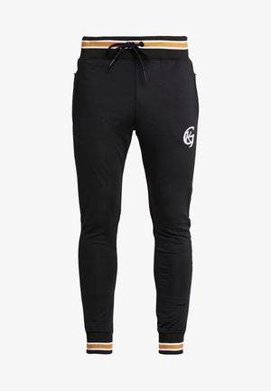 TRACKSUIT JOGGER WITH STRIPED OCHRE RIB - Pantalones deportivos - black