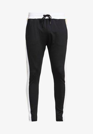 TROUSERS WITH FOIL PRINT - Teplákové kalhoty - black