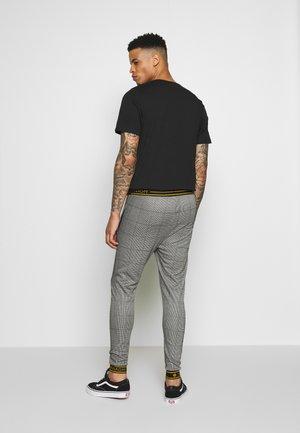 TARTAN TROUSERS - Pantalon de survêtement - grey