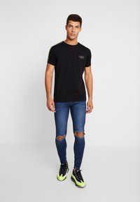 Gianni Kavanagh - RIPPED KNEES - Jeans Skinny - blue - 1
