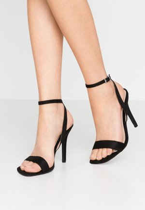Korolliset sandaalit - black