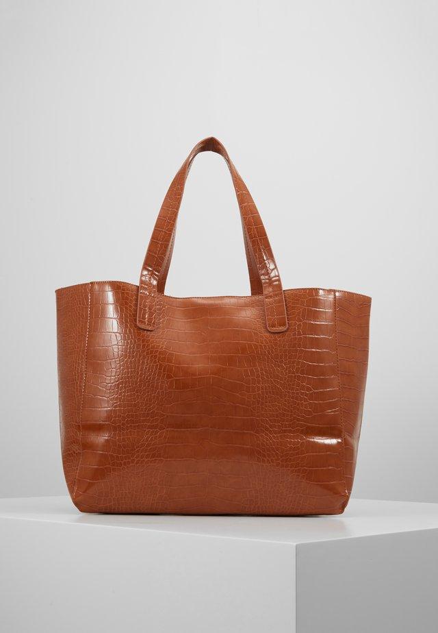 Käsilaukku - tan
