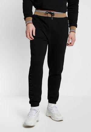 MULLEN - Spodnie treningowe - black