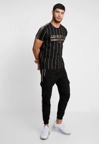 Glorious Gangsta - ALPHA JOGGER - Pantalon de survêtement - black - 1