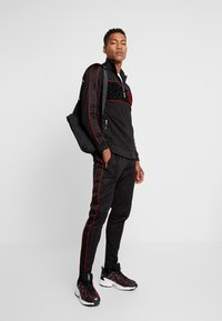Glorious Gangsta - CORTZEE JOGGERS - Tracksuit bottoms - black - 1