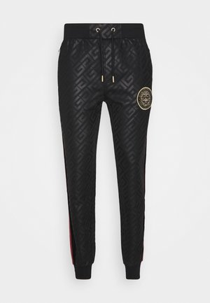 ALANIS JOGGERS - Tracksuit bottoms - black