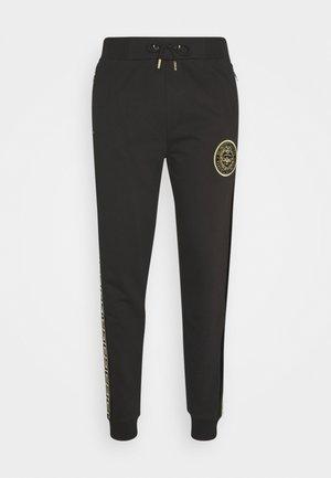 RODELL JOGGER - Pantalon de survêtement - black/gold