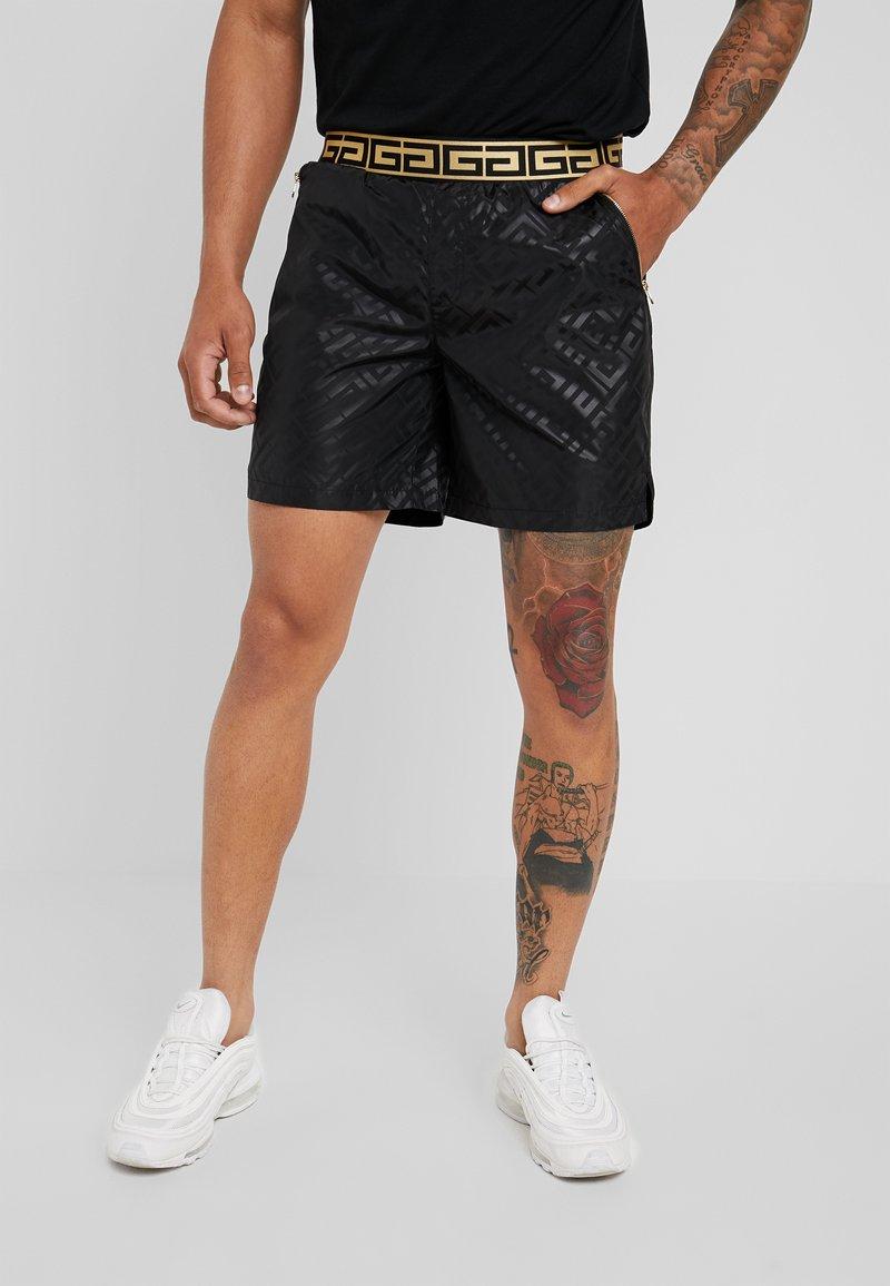 Glorious Gangsta - JANUS - Tracksuit bottoms - black