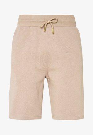 KALK - Spodnie treningowe - sand