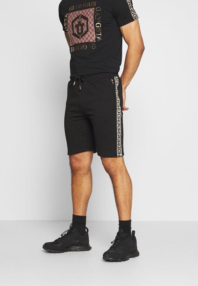 KALK - Træningsbukser - black
