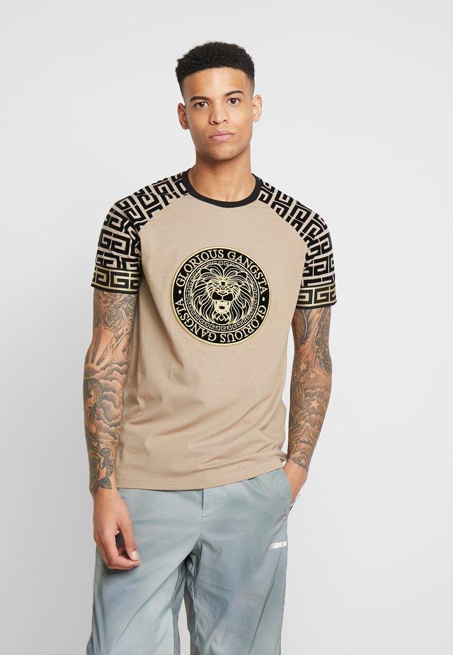 NAPOLI - T-shirt med print - sand