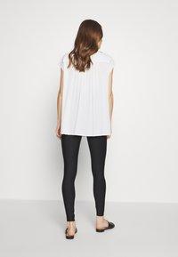 GLOWE - LEVANTA OVERBUMP - Leggings - Trousers - black - 2