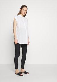GLOWE - LEVANTA OVERBUMP - Leggings - Trousers - black - 1