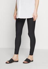 GLOWE - LEVANTA OVERBUMP - Leggings - Trousers - black - 0