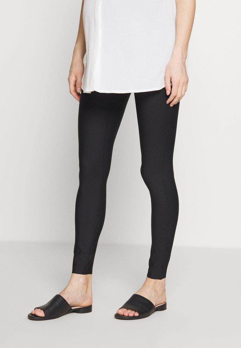 GLOWE - LEVANTA OVERBUMP - Leggings - Trousers - black